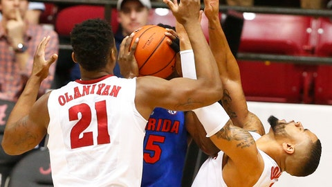 Alabama guard Corban Collins is fouled by Florida center John Egbunu during the second half of an NCAA college basketball game, Tuesday, Jan. 10, 2017, in Tuscaloosa, Ala. Florida won 80-67. (AP Photo/Brynn Anderson)