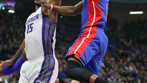 Detroit Pistons guard Reggie Jackson (1) drives to the basket against Sacramento Kings defender DeMarcus Cousins (15) during the first half of an NBA basketball game in Sacramento, Calif., Tuesday, Jan. 10, 2017. (AP Photo/Steve Yeater)