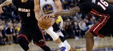 Curry, Durant lead Warriors past Heat 107-95