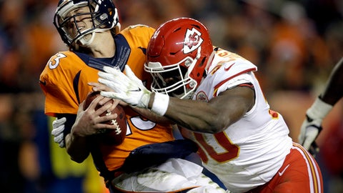 FILE - In this Nov. 27, 2016, file photo, Kansas City Chiefs outside linebacker Justin Houston (50) sacks Denver Broncos quarterback Trevor Siemian (13) in the end zone for a safety during the first half of an NFL football game, in Denver. Ben Roethlisberger shreded Kansas City for five touchdowns when the teams met in the regular season. But the Chiefs were without star pass rusher Justin Houston in that matchup, and despite lingering knee issues, there is hope he'll play on Sunday.(AP Photo/Joe Mahoney, File)