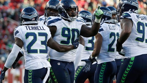 FILE - In this Jan. 1, 2017, file photo, Seattle Seahawks defensive tackle Jarran Reed (90) gestures after being ejected during the second half of an NFL football game against the San Francisco 49ers, in Santa Clara, Calif. The Seahawks rookie is among a handful of young players seeing how the college football playoffs translates to the NFL playoffs. (AP Photo/Tony Avelar)