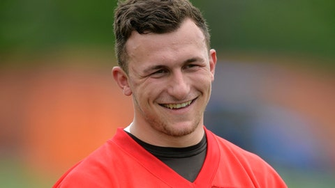 FILE - In this May 26, 2015, file photo, then-Cleveland Browns quarterback Johnny Manziel smiles during an NFL football organized team activity, in Berea, Ohio. Johnny Manziel will be in Houston ahead of the Super Bowl to give fans a chance to take a photo with the 2012 Heisman trophy winner — at a price. (AP Photo/David Richard, File)