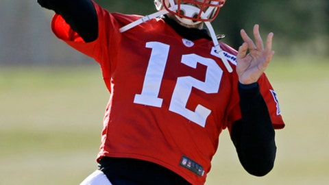 New England Patriots quarterback Tom Brady (12) throws a pass during NFL football practice, Wednesday, Jan. 11, 2017, in Foxborough, Mass. (AP Photo/Elise Amendola)