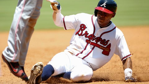 Atlanta Braves' Mallex Smith steals third base in the fifth inning of a baseball game against the Cincinnati Reds, Thursday, June 16, 2016, in Atlanta. (AP Photo/Brett Davis)
