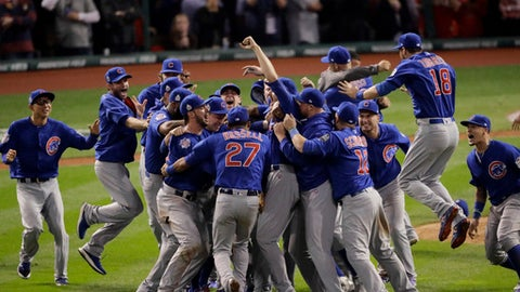 "FILE - In this Nov. 3, 2016, file photo, the Chicago Cubs celebrate after Game 7 of the Major League Baseball World Series against the Cleveland Indians, in Cleveland. The World Series champion Chicago Cubs have accepted President Barack Obama's invitation and will visit the White House on Monday, Jan. 16, 2017. White House press secretary Josh Earnest said Wednesday that Obama is ""really looking forward to it"" and that any sports fan could appreciate ""the historic run that the Chicago Cubs had through the playoffs and to a World Series title this year."" (AP Photo/Charlie Riedel, File)"