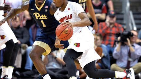 Louisville's Donovan Mitchell (45) attempts to drive around the defense of Pittsburgh's Jamel Artis (1) during the first half of an NCAA college basketball game, Wednesday, Jan. 11, 2017, in Louisville, Ky. (AP Photo/Timothy D. Easley)
