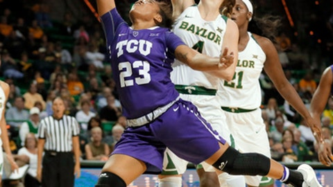 TCU guard AJ Alix (23) attempts a shot as Baylor's Kristy Wallace (4) of Australia defends in the first half of an NCAA college basketball game, Wednesday, Jan. 11, 2017, in Waco, Texas. (AP Photo/Tony Gutierrez)