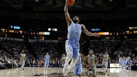 North Carolina's Joel Berry II (2) drives to the basket against Wake Forest during the first half of an NCAA college basketball game in Winston-Salem, N.C., Wednesday, Jan. 11, 2017. (AP Photo/Chuck Burton)