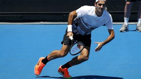 Switzerland's Roger Federer looks to return a shot during a practice session ahead of the Australian Open tennis championships in Melbourne, Australia, Thursday, Jan. 12, 2017. (AP Photo/Mark Baker)