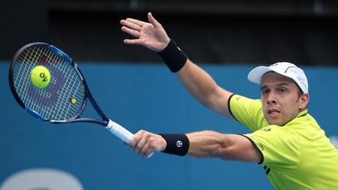 Gilles Muller of Luxembourg plays a shot to Pablo Cuevas of Uruguay during their men's quarterfinal singles match at the Sydney International tennis tournament in Sydney Thursday, Jan. 12, 2017. (AP Photo/Rick Rycroft)