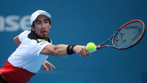 Pablo Cuevas of Uruguay plays a shot to Gilles Muller of Luxembourg during their men's quarterfinal singles match at the Sydney International tennis tournament in Sydney Thursday, Jan. 12, 2017. (AP Photo/Rick Rycroft)