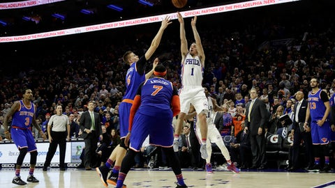 Philadelphia 76ers' T.J. McConnell (1) takes the game-winning shot against New York Knicks' Kristaps Porzingis (6) and Carmelo Anthony (7) during the final seconds of an NBA basketball game, Wednesday, Jan. 11, 2017, in Philadelphia. Philadelphia won 98-97. (AP Photo/Matt Slocum)