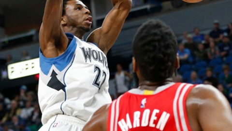 Minnesota Timberwolves' Andrew Wiggins, left, dunks as Houston Rockets' James Harden looks on during the first quarter of an NBA basketball game Wednesday, Jan. 11, 2017, in Minneapolis. (AP Photo/Jim Mone)