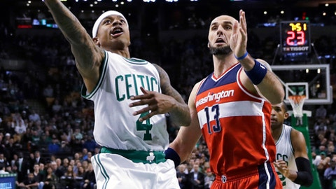 Boston Celtics guard Isaiah Thomas (4) drives to the basket past Washington Wizards center Marcin Gortat, of Poland, during the first quarter of an NBA basketball game in Boston, Wednesday, Jan. 11, 2017. (AP Photo/Charles Krupa)