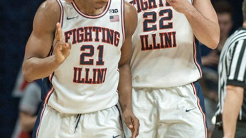 Illinois center Maverick Morgan (22) and Illinois guard Malcolm Hill (21) react after Hill was fouled on a basket during the second half of an NCAA college basketball game against Michigan in Champaign, Ill., on Wednesday, Jan. 11, 2017. (AP Photo/Rick Danzl)