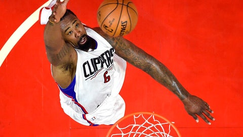 Los Angeles Clippers center DeAndre Jordan shoots during the first half of the team's NBA basketball game against the Orlando Magic, Wednesday, Jan. 11, 2017, in Los Angeles. (AP Photo/Mark J. Terrill)