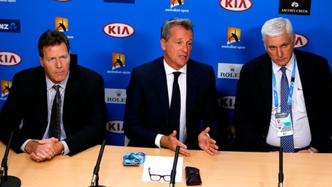 FILE - In this  Jan. 18, 2016 file photo, ATP chairman Chris Kermode, center, with Nigel Willerton, right, head of the Tennis Integrity Unit and ATP Vice Chairman Mark Young, speaks during a press conference at the Australian Open tennis championships in Melbourne, Australia. Match-fixing is back in the tennis spotlight, bringing fresh scrutiny to the integrity of the sport a year after corruption allegations cast a pall over the first Grand Slam of the year. (AP Photo/Shuji Kajiyama, File)