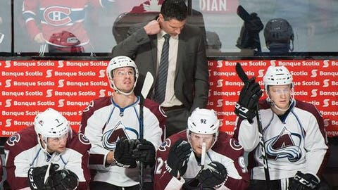 FILE - In this Dec. 10, 2016, file photo, Colorado Avalanche head coach Jared Bednar looks down from behind the bench during the second period of an NHL hockey game in Montreal.This is a team that's laboring to score goals (a league-low 79), stop offensive rushes (129 goals allowed) and has an NHL-worst 5-13-1 record on home ice. (Graham Hughes/The Canadian Press via AP, File)