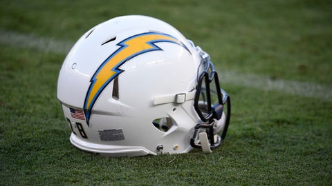 FILE - In this Sept. 1, 2016, file photo, a San Diego Chargers helmet sits on the field before a preseason NFL football game against the San Francisco 49ers, in San Diego. The Chargers are moving to Los Angeles, where they will join the recently relocated Rams in giving the nation's second-largest media market two NFL teams for the first time in decades. The announcement was made Thursday, Jan. 12, 2017. (AP Photo/Denis Poroy, FIle)