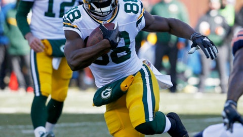 FILE - In this Dec. 18, 2016, file photo, Green Bay Packers running back Ty Montgomery (88) runs for a touchdown against the Chicago Bears as quarterback Aaron Rodger (12) looks on during the first half of an NFL football game, in Chicago. The first time Montgomery scored a touchdown on the Dallas Cowboys' home turf he was a kid playing Pop Warner football during halftime of a Cowboys game at Texas Stadium. Now Montgomery, who is from Dallas, has a chance to do it again, but this time as an NFL player. Green Bay travels to Dallas on Sunday for a divisional round playoff game at the Cowboys' current home, AT&T Stadium.(AP Photo/Nam Y. Huh, File)