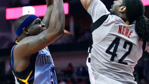 Houston Rockets center Nene Hilario (42) blocks the shot of Memphis Grizzlies forward Zach Randolph in the first half of an NBA basketball game, Friday, Jan. 13, 2017, in Houston. (AP Photo/Eric Christian Smith)