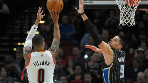 Portland Trail Blazers guard Damian Lillard shoots over Orlando Magic center Nikola Vucevic during the first half of an NBA basketball game in Portland, Ore., Friday, Jan. 13, 2017. (AP Photo/Steve Dykes)
