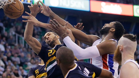 Utah Jazz center Rudy Gobert (27) and Detroit Pistons center Andre Drummond, right, reach for a rebound during the first half of an NBA basketball game Friday, Jan. 13, 2017, in Salt Lake City. (AP Photo/Rick Bowmer)