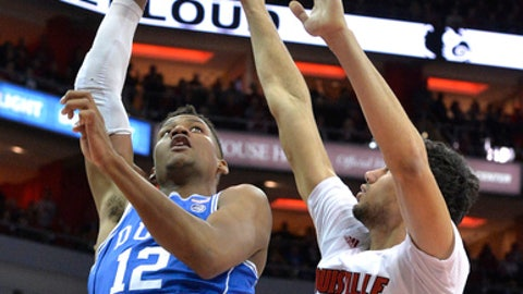 Duke's Javin DeLaurier (12) has his shot blocked by Louisville's Anas Mahmoud (14) during the first half of an NCAA college basketball game, Saturday, Jan. 14, 2017, in Louisville, Ky. (AP Photo/Timothy D. Easley)