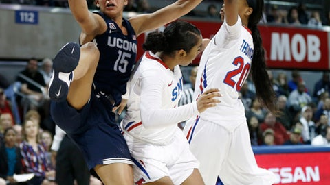 Connecticut guard Gabby Williams (15) reaches for a loose ball as SMU guard Mikayla Reese, center, and forward Dai'ja Thomas (20) defend during the first half of an NCAA college basketball game, Saturday, Jan. 14, 2017, in Dallas. (AP Photo/Brandon Wade)