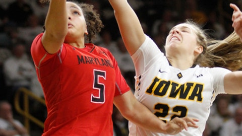 Maryland's Destiny Slocum (5) goes to the basket in front of Iowa's Kathleen Doyle (22) during the first half of an NCAA college basketball game, Saturday, Jan. 14, 2017, in Iowa City, Iowa. (AP Photo/Matthew Holst)f