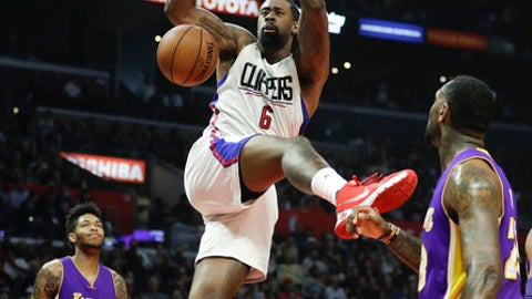 Los Angeles Clippers' DeAndre Jordan, center, dunks as Los Angeles Lakers' Brandon Ingram, background left, and Tarik Black watch during the first half of an NBA basketball game Saturday, Jan. 14, 2017, in Los Angeles. (AP Photo/Jae C. Hong)