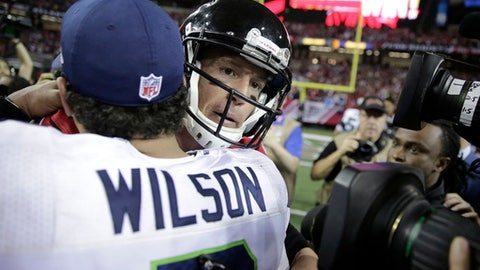Atlanta Falcons quarterback Matt Ryan, right, embraces Seattle Seahawks quarterback Russell Wilson after an NFL football divisional football game, Saturday, Jan. 14, 2017, in Atlanta. The Falcons won 36-20. (AP Photo/David Goldman)