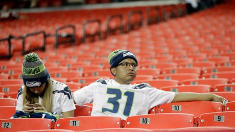 Seattle Seahawks fans sit in the stands after an NFL football divisional football game between the Atlanta Falcons and the Seattle Seahawks, Saturday, Jan. 14, 2017, in Atlanta. The Falcons won 36-20. (AP Photo/David Goldman)