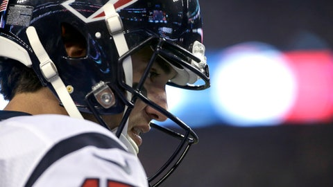 Houston Texans quarterback Brock Osweiler stands on the sideline near the end of the team's NFL divisional playoff football game against the New England Patriots, Saturday, Jan. 14, 2017, in Foxborough, Mass. (AP Photo/Steven Senne)