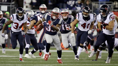 New England Patriots running back Dion Lewis (33) runs for a touchdown against the Houston Texans during the first half of an NFL divisional playoff football game, Saturday, Jan. 14, 2017, in Foxborough, Mass. (AP Photo/Elise Amendola)