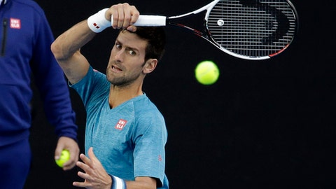 Serbia's Novak Djokovic makes a forehand return during a practice session ahead of the Australian Open tennis championships in Melbourne, Australia, Sunday, Jan. 15, 2017. (AP Photo/Aaron Favila)