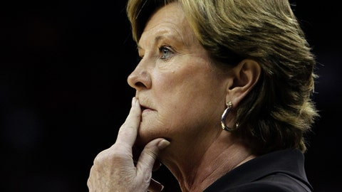 FILE - In this Nov. 12, 2010, file photo, Tennessee coach Pat Summitt watches her team against Louisville in an NCAA college basketball game in Louisville, Ky. For every home game during the fall 2016-17 basketball season, a chair of Tennessee's bench is left vacant to honor former coach Summitt, who died June 28, 2016. But the Lady Vols aren't the only team paying tribute to Summitt. Harvard, Vermont and Kentucky are among the Division I teams joining Tennessee in wearing commemorative patches to honor one of the game's greatest ambassadors.  (AP Photo/Garry Jones, File)