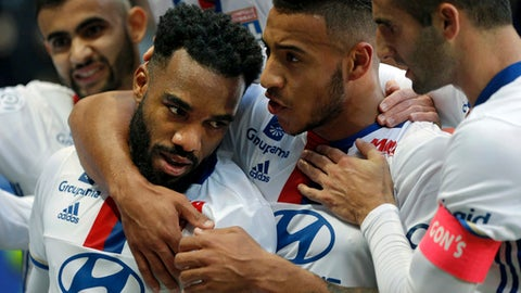 FILE - In this Saturday, Oct. 22, 2016 file photo, Lyon's Alexandre Lacazette, left, celebrates with teammates after scoring against Guingamp during their French League One soccer match in Decines, near Lyon, central France. Alexandre Lacazette scored twice on Sunday Jan. 15, 2017, to take his season's tally to 15 league goals in 15 games, but it wasn't enough as Lyon lost 3-2 away to Caen. (AP Photo/Laurent Cipriani, File)