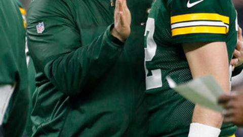 Green Bay Packers coach Mike McCarthy, left, talks with quarterback Aaron Rodgers (12) before an NFL divisional playoff football game against the Dallas Cowboys Sunday, Jan. 15, 2017, in Arlington, Texas. (AP Photo/Tony Gutierrez)