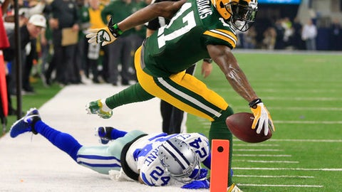 Green Bay Packers wide receiver Davante Adams (17) steps out of bounds short of the goal line as Dallas Cowboys cornerback Morris Claiborne (24) defends during the first half of an NFL divisional playoff football game Sunday, Jan. 15, 2017, in Arlington, Texas. (AP Photo/Ron Jenkins)