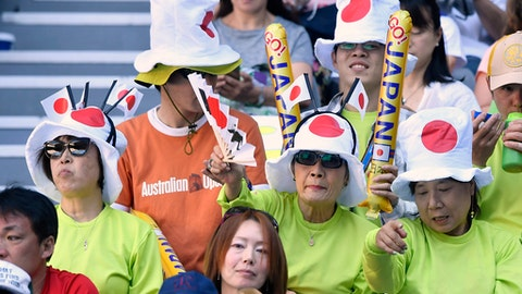 Fans wait for Japan's Kei Nishikori and Russia's Andrey Kuznetsovduring before their first round match at the Australian Open tennis championships in Melbourne, Australia, Monday, Jan. 16, 2017. (AP Photo/Andy Brownbill)