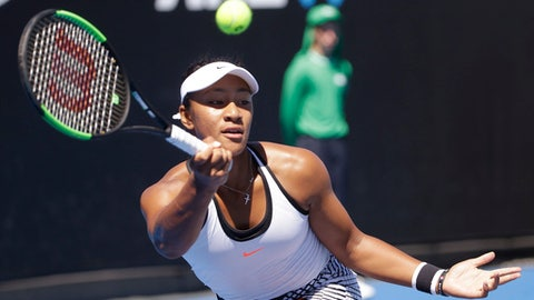 Australia's Destanee Aiava reaches to play a forehand to Germany's Mona Barthel during their first round match at the Australian Open tennis championships in Melbourne, Australia, Monday, Jan. 16, 2017. (AP Photo/Dita Alangkara)