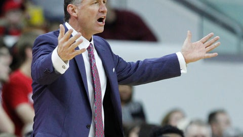 North Carolina State head coach Mark Gottfried reacts to a call during the first half of an NCAA college basketball game against Georgia Tech in Raleigh, N.C., Sunday, Jan. 15, 2017. (Ethan Hyman/The News & Observer via AP)