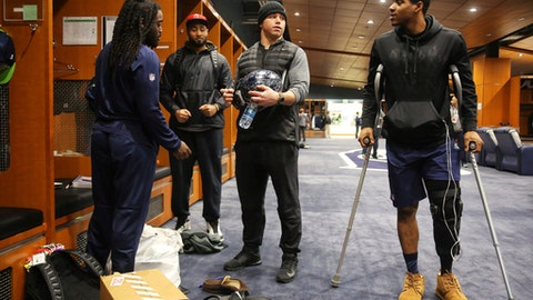 Seattle Seahawks running back Alex Collins, from left, linebacker K.J. Wright, linebacker Brock Coyle and cornerback DeShawn Shead chat as players clean out their lockers at the Virginia Mason Athletic Center in Renton, Wash., Sunday, Jan. 15, 2017. The team played their final game of the season Saturday. (Genna Martin/seattlepi.com via AP)