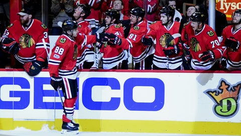 Chicago Blackhawks right wing Patrick Kane (88) celebrates with teammates after his goal against the Minnesota Wild during the first period of an NHL hockey game on Sunday, Jan. 15, 2017, in Chicago. (AP Photo/Matt Marton)