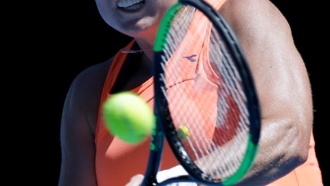 Shelby Rogers of the United States hits a backhand to Romania's Simona Halep during their first round match at the Australian Open tennis championships in Melbourne, Australia, Monday, Jan. 16, 2017. (AP Photo/Aaron Favila)