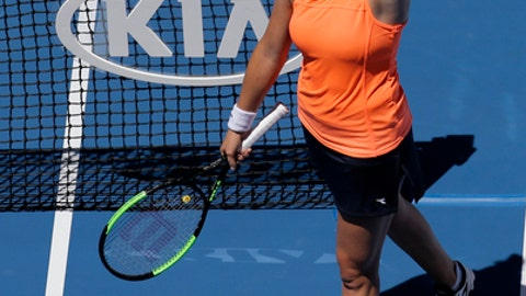 Shelby Rogers of the United States celebrates her win over Romania's Simona Halep in their first round match at the Australian Open tennis championships in Melbourne, Australia, Monday, Jan. 16, 2017. (AP Photo/Aaron Favila)