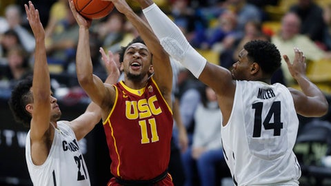 USC guard Jordan McLaughlin, center, drives the lane for a basket as Colorado guard Derrick White, left, and forward Tory Miller defend late in the first half of an NCAA college basketball game Sunday, Jan. 15, 2017, in Boulder, Colo. (AP Photo/David Zalubowski)