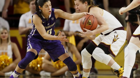 Washington State's Kelsey Plum (10), left, and Arizona guard Sydney Goodson (13) battle for a loose ball in the first half of an NCAA college basketball game in Tempe, Ariz., Sunday, Jan. 15, 2017. Arizona won 56-55. (Ben Moffat/The Arizona Republic via AP)