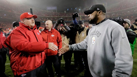 Kansas City Chiefs head coach Andy Reid, left, talks with Pittsburgh Steelers head coach Mike Tomlin, right, after an NFL divisional playoff football game Sunday, Jan. 15, 2017, in Kansas City, Mo. The Steelers won 18-16. (AP Photo/Charlie Riedel)
